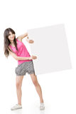 Young pretty woman holding a blank. On the white background Royalty Free Stock Photography