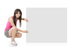 Young pretty woman holding a blank Stock Photography