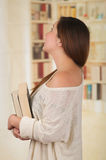 Young Pretty Woman holding a book Stock Photo