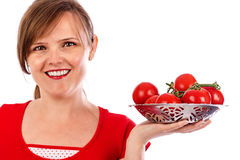 Young pretty woman holding a bowl of ripe tomatoes Royalty Free Stock Image