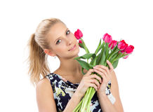 Young pretty woman holding a bunch of red tulips bouquet Stock Image
