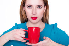 Young pretty woman holding a cup of tea or coffee Royalty Free Stock Photo