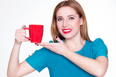 Young pretty woman holding a cup of tea or coffee Royalty Free Stock Photography