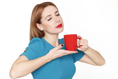 Young pretty woman holding a cup of tea or coffee Stock Images