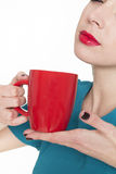 Young pretty woman holding a cup of tea or coffee Stock Photos