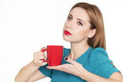 Young pretty woman holding a cup of tea or coffee Stock Photo