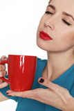 Young pretty woman holding a cup of tea or coffee Royalty Free Stock Image