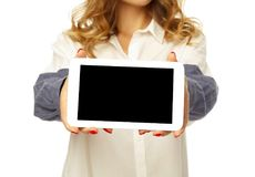 Young pretty woman holding empty tablet in hands Stock Image