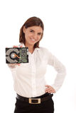 Young pretty woman holding hard disc Royalty Free Stock Images