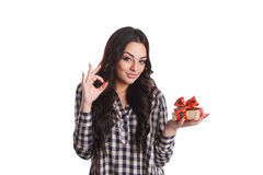 Young pretty woman holding a present Stock Images