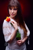 Young pretty woman holding red tulip Royalty Free Stock Photography