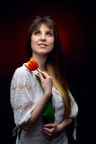 Young pretty woman holding red tulip Stock Image
