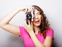 Young pretty woman holding vintage camera Royalty Free Stock Photography