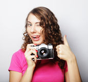 Young pretty woman holding vintage camera Royalty Free Stock Images
