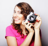 Young pretty woman holding vintage camera Stock Image