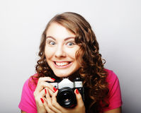 Young pretty woman holding vintage camera Stock Images