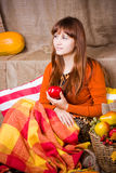Young pretty woman holds an apple Royalty Free Stock Image