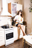 Young pretty woman housewife cooking on kitchen, house interior, lifestyle people concept Royalty Free Stock Image