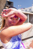 Young pretty woman in the indian festival Holi. Tenerife. Spain stock images