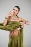 Young pretty woman in indian green dress Royalty Free Stock Images