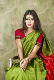 Young pretty woman in indian green dress Stock Photo