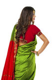 Young pretty woman in indian green dress Royalty Free Stock Image