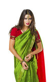 Young pretty woman in indian green dress Stock Image