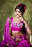Young pretty woman in indian red dress Royalty Free Stock Photography