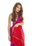 Young pretty woman in indian red dress Royalty Free Stock Images