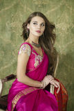 Young pretty woman in indian red dress Royalty Free Stock Photos