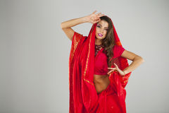 Young pretty woman in indian red dress Stock Photos