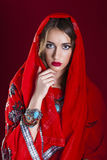 Young pretty woman in indian red dress Stock Photo