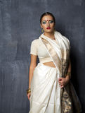 Young pretty woman in indian white dress Royalty Free Stock Image