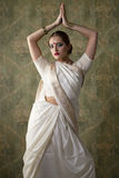 Young pretty woman in indian white dress Stock Photo