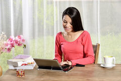 Young pretty woman Ipad looking away Stock Photo