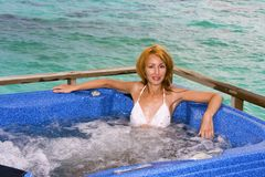 Young pretty woman in jacuzzi Royalty Free Stock Photography