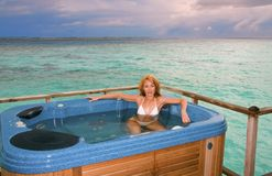 Young pretty woman in jacuzzi on background of oce Royalty Free Stock Photo