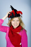 Young pretty woman with a jocker hat Royalty Free Stock Photography