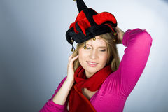 Young pretty woman with a jocker hat Stock Image