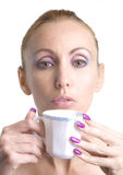 Young pretty woman keeps cup with long nails Royalty Free Stock Photos