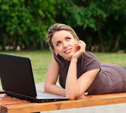 Young pretty woman with laptop Royalty Free Stock Images
