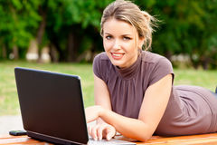 Young pretty woman with laptop Royalty Free Stock Photography