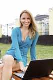 Young pretty woman with laptop Stock Photography