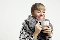 Young pretty woman laughing with a white cup. Concept design layout. Royalty Free Stock Photo