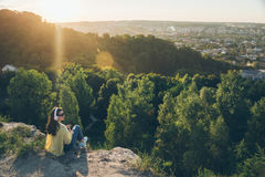 Young pretty woman listing music on the top of the hill. On sunset Royalty Free Stock Photos