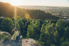 Young pretty woman listing music on the top of the hill. On sunset Stock Photos