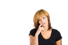 Young pretty woman looking away being guilty about something, biting finger Royalty Free Stock Photos