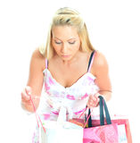Young pretty woman looking into shop bag. Stock Photos