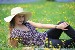 Young and pretty woman lying on a flowery meadow stock photos