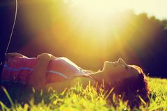 Free Young Pretty Woman Lying On The Grass At Summer Sunset Stock Photos - 33599733
